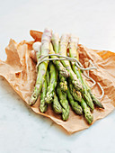 Green asparagus on wax paper