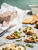 Toasted bread with liver pate, cauliflower and capers