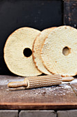 Rolling pin with flatbread on background