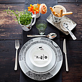 A modern place setting in black and white