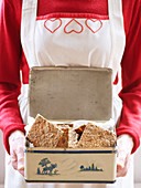 Woman holding bread in box
