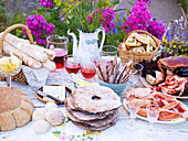 A Scandinavian buffet with bread and crayfish in a garden