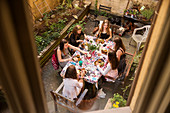 Teenage girls having meal on courtyard