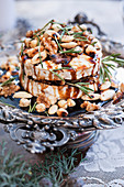 Goat's cheese with nuts, caramel sauce and rosemary