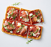 Bread pizza with cream cheese and cured ham