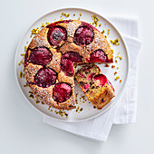 Plum cake with chocolate and pistachios