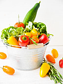 Fresh vegetables and salad in a tin bucket