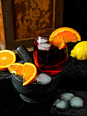 Gin and tonic with martini and orange slices