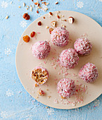 Energy balls with pink grated coconut