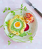 Potato mash with egg, green sauce and raw salad