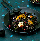 Lentil salad with fried pineapple and fried feta cheese
