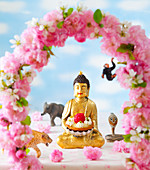 Buddha with a raspberry tart and flower decoration