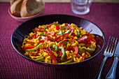 Paella with saffron, chorizo and peppers