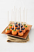 Salmon pops with caviar and chives
