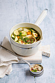 Chicken soup with red camarque rice and vegetables
