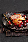 Fried yeast cakes with preserved cherries