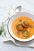 Smoked pepper and pumpkin soup with fish cakes