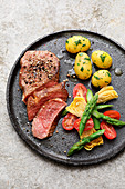 Peppered steak with herb potatoes and an artichoke medley