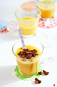 Papaya smoothie with banana and biscuit crumbs