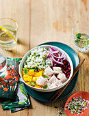 Hake poke bowl with green coconut rice