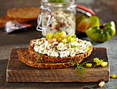 Wholemeal bread with feta, olive and tomato cream and green tomatoes