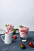 Strawberry mousse in a glass with strawberry sauce