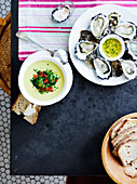 Freshly shucked oysters with tarragon dressing and cucumber soup