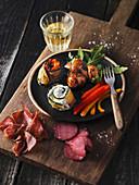 Antipasti platter with ostrich ham and ostrich salami