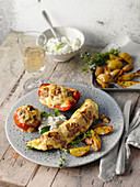 Stuffed summer vegetables with roast potatoes