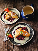 Semolina slices with red berry jelly and vanilla sauce