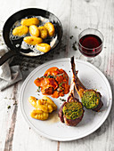 Lamb chops with a wild garlic crust on a bed of ratatouille