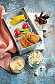 Lunch box with crackers and dips