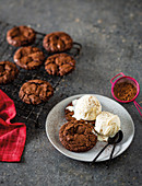Chocolate brownie cookies with vanilla ice cream