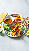 Coconut prawns with chilli-lime dressing and green mayo