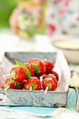 Strawberries skewers with basil