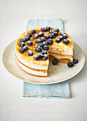 Mini quark-cream cake with apricots and blueberries