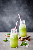 Healthy green juice with zucchini, pineapple, ginger, lemon and mint