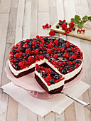 Sour cream brownie cake with fresh berries