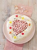A heart-shaped cream cheese cake with raspberries