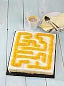 A labyrinth cake with peach purée