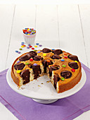 Ice cream cone marble cake decorated with chocolate beans