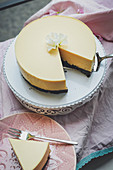A cheesecake with a chocolate base, nectarines and oranges