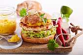 Chicken burger with guacamole, chillies and mango salsa