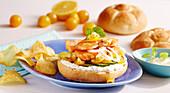 Salmon burger with homemade lemon mayonnaise and potato chips