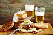 Grilled burgers with fennel and apple salad and beer