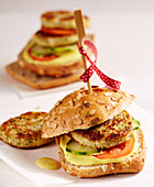 Vegetarian cauliflower burgers made with potatoes, breadcrumbs with curry mayonnaise, and yoghurt on a wholemeal roll