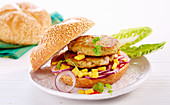 Salmon shrimp burgers with mango, red onions and chili jelly