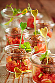 Summer party snack: fried meatballs with tomato salsa in mason jars
