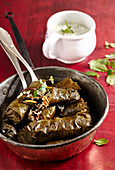 Dolmades with rice filling and yoghurt sauce (Turkey)