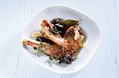 Marinated braised rabbit with black olives (Spain)